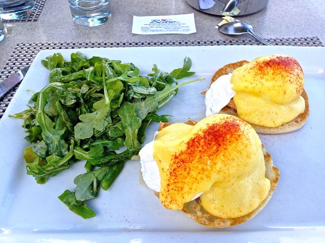 close-up of eggs benedict with arugula at westin key west