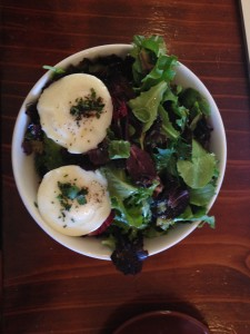 poached eggs on mixed greens in berkley