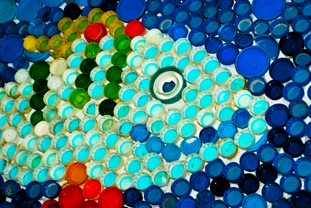 Exuma Go Green fish mural made from bottlecaps